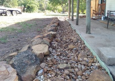 Dry creek bed drainage systems